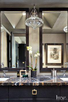 Spectrus granite and glass surround this contemporary master bath.
