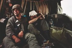 US Sergeant Ken Kozakiewicz (23), gives vent to his grief as he learns that the body bag at his feet contains the remains of his friend Andy Alaniz. 'Friendly fire' claimed Alaniz's life and injured Kozakiewicz. On the last day of the Gulf War they were taken away from the war zone by a MASH unit evacuation helicopter. (David Turnley)