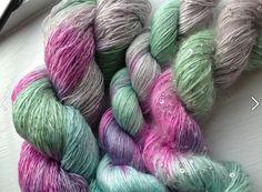 Color 153 Left to right: Ensemble Glitter Light, Silk Essence, Beaded Mohair & Sequins