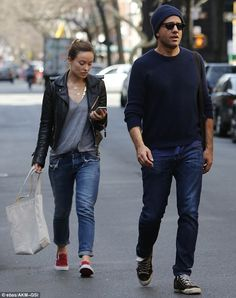 Stylish outing: She hit the pavement in black and red slip-on shoes with a motorcycle jack...