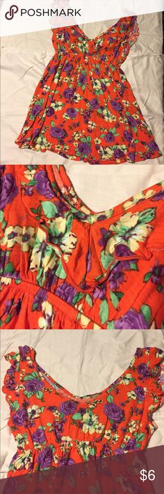 Bright orange floral babydoll Top This shirt reminds me of the Caribbean, a red-orange with pops of purple and yellow flowers. With a floral frilly v-neckline! Tops Blouses