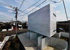 Torus house and pet shop by Norisada Maeda Atelier