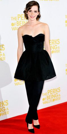 Emma Watson walked the red carpet at the London premiere of The Perks of Being a Wallflower in Dior's black ensemble, a key pendant and pointy-toe pumps.