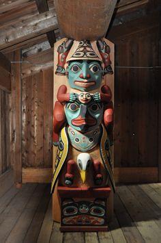 Tlingit house post in the clan house at the Alaska Native Heritage Center in Anchorage Alaska. Artist Israel Shotridge.