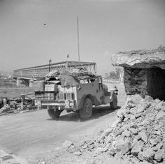 An M3A1 White scout car moves up to the Catania Plain across the Primosole Bridge.