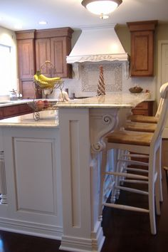 Splendid Houzz Kitchen Islands with Corbels and Vintage Wood Counter Stools in White also 2-tier Iron Wire Fruit Basket on Top of Bianco Romano Granite Countertops from Kitchen Island Plans