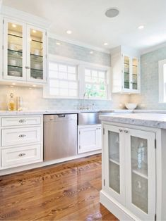 Blue Subway Tile Backsplash – To the ceiling gray subway, window, glass fronts.