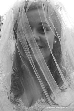Bride looking through her veil. Taken by Mark Huntley Wedding Photography www.markhuntley.co.uk #Eastbourne #EastSussex