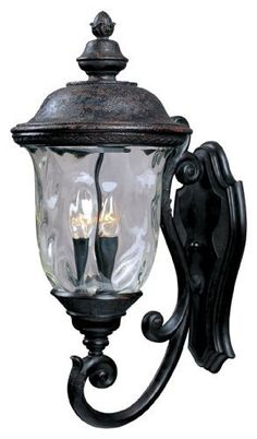 Maxim Lighting 3424WGOB Carriage House DC 3-Light Bottom Mount Outdoor 26.5-Inch Wall Lantern, Oriental Bronze Finish by Maxim Lighting. $139.49. From the Manufacturer                The Maxim Lighting 3424WGOB Carriage House DC Collection 3-light Outdoor Wall Lantern is made of die cast aluminum and finished in an oriental bronze while being paired with a beautiful water glass shade. It will complement your transitional decor and provide years of satisfaction with the its ea...