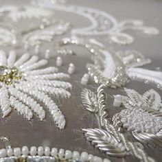 Bridal couture detail| #handembroidery #tambour #beading #weddingdress #silver…