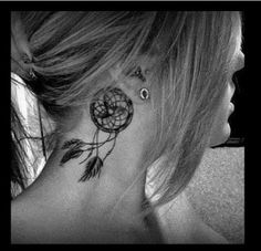 Dreamcatcher neck tattoo. Not in that spot but think i really like the dreamcatcher