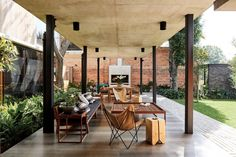 The team chose a simple material palette including exposed concrete and ipe wood to run throughout the house. Outdoor Seating Areas, Outdoor Lounge, Outdoor Dining, Outdoor Spaces, Outdoor Decor, Dining Area, Dining Room, Dining Table, Terracotta Floor