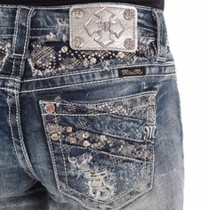 NWT Miss Me Crushed Mid-Rise Bootcut Jeans Feel like a million bucks in a pair of shimmering boot cut jeans with tons of embellishments on yoke and back pockets, detailed with fading, whiskering, logo hardware, and contrast stitching. Miss Me Jeans Boot Cut