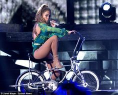 Jennifer Lopez takes on cycle chic. Love the pairing of nude fishnets with a classic Schwinn Stingray.