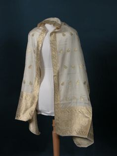 Stole - Ivory silk with woven repeated motifs, narrow side borders and deeper end borders all in gold thread - in Indian style designs. 1800 - 1820    National Trust Collections