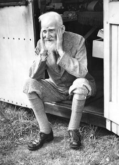 Irish playwright George Bernard Shaw - sits in the doorway of the garden shed at his home in Ayot St Lawrence, Hertfordshire, where he does most of his writing, July 1946 B/W Photo Colourised by Pearse. George Bernard Shaw, Book Writer, Book Authors, Whiskey Quotes, Writers And Poets, People Of Interest, Playwright, Portraits, Great Words