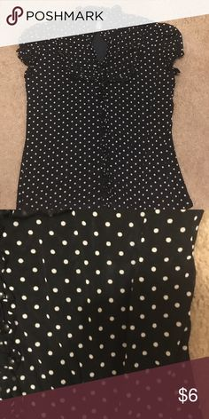 Polka dot shirt Polka dot shirt. It has tiny ruffle sleeves, and a ruffle neckline, and buttons down the front. Tops Button Down Shirts