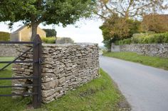 Dry stone wall and gate by Britt Willoughby Dyer.