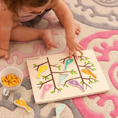 A timeless toy done DwellStudio style, this wooden puzzle turns counting and color recognition to play with 6 numbered bird pieces. Puzzle meets all safety testing standards. Ages 3 and up. #LGRoselynNursery