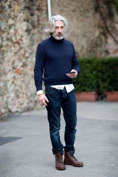 On the Florence street… Red Wing boots… dark washed jeans… navy turtleneck layered over white shirt… rugged spring look.: