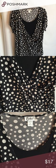 Ladies black and white polka dot top worn once 2x Ladies black and white illusion top with attached black cami layer that is under the cross over polka dot top . Side offers rushing gathers for a slimming effect where the cross over happens at waistline  . Super cute design and worn once carducci Tops Tees - Short Sleeve