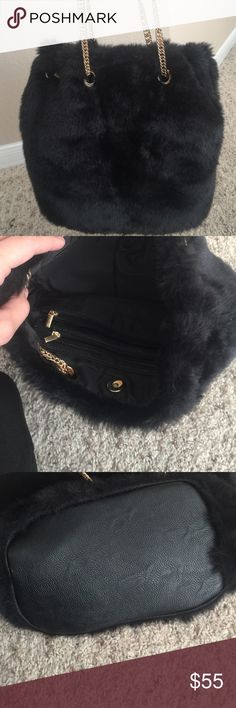Faux fur handbag Black faux fur handbag with gold chain. Multiple pockets and pouches inside. New. Bag measures 14 inches across, 10 inches too to bottom. Chain 11 inches. Bags Shoulder Bags
