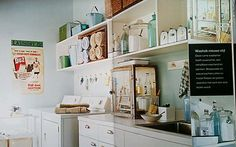 vintage inspired laundry room - loving the metal science cabinet on the counter