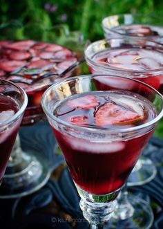 Summer Sangria with Rum  1 bottle red wine (I used a Pinot Noir)  1 cup light rum (such as Bacardi Puerto Rican Rum)  1 cup simple syrup (see recipe below)  2 plums, pitted and sliced  1 pint cherries, pitted  1 pint strawberries, sliced  sprig of mint, optional  12 oz lime soda