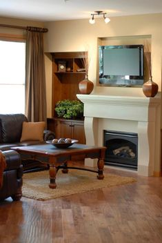 This fireplace is completely seamless, and flows upwards towards the television. The communal area is centered around the fireplace, the floor boards moving towards the middle. Mounted Fireplace, Tv Above Fireplace, Wooden Fireplace, Home Fireplace, Fireplace Surrounds, Fireplaces, Loft Staircase, Mounted Tv, Contemporary Style