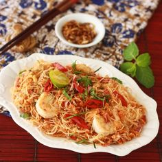 Spicy, sweet, and sour noodle salad dish with Southeast Asian spices & herbs - called Nyonya Kerabu Bee Hoon. (http://blog.seasonwithspice.com/2012/03/nyonya-kerabu-bee-hoon.html)