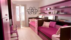 Pink beds. Love the painted wall with shelves - so interesting!