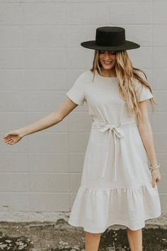 This neutral-colored linen dress is perfect addition to minimal closet! Hanover Linen Dress features short sleeves, ruffle hem, and wooden button keyhole closure on back. Sewn-in waist tie ensures flattering fit. Linen Dresses, Modest Dresses, Cotton Dresses, Cute Dresses, Casual Dresses, Summer Dresses, Flower Dresses, Casual Attire, Cheap Dresses