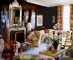 """""""The shiny walls glitter at night and glitter during the day, reflecting the lights of the city,"""" Mario Buatta says of Hilary Geary and Wilbur Ross's apartment on the 30th floor of a Manhattan high-rise.The living room. Sconce from Liz O'Brien. Scalamandré sofa fabric."""