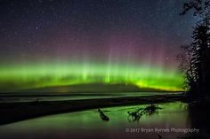 Northern lights over Lake Superior and the mouth of the Misery River near Toivola.
