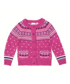 Layer little lovelies in the warmth of this UK-designed cardigan. With a Fair Isle print and buttons up the front, it has kid-friendly comfort and cuteness down pat.