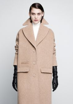 & OTHER STORIES Crafted from a soft wool-blend, this coat has a sophisticated, feminine style, featuring clean, straight lines, a wide collar, and dropped shoulders.