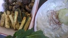 Oven-baked zucchini and mushrooms in spicy breadcrumbs. Yoghurt and fresh cucumber dip.