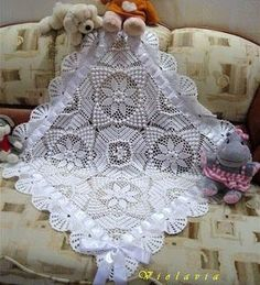 Georgous!! Covers to Crochet: The blanket of Baptism! charted pattern given. This is the most beautiful piece of crochet I have ever seen. I hope it will translate to English.