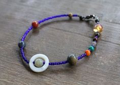 A bracelet with colorful beads to represent all the planets in our solar system. | 36 Gifts That Will Take Any Space Lover To Another Galaxy