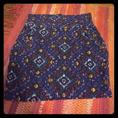 Tribal print Delias mini skirt Very comfy! Only warn once. Size medium but will definitely fit a small as well! Stretch material and tight! Love this skirt ! Delias Skirts Mini