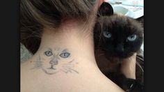 Cat face tattoo on the neck