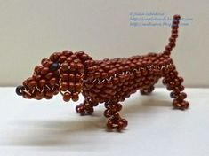 Dachshund out of beads and wire in the technique of 3D beading. Free detailed tutorial.