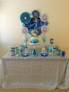 Blue and white dessert table at a Frozen birthday party! See more party planning ideas at CatchMyParty.com!
