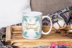 """A lovely, gift for a special someone who has completed Umrah pilgrimage. You will receive 1 ceramic Mug """"Umrah Mubarak"""" with the Year Printed on both sides Islamic Gift Mug. Ceramic Mugs are 10oz and the image shown appears on both sides of the mug ( suitable for the left-handed person)."""