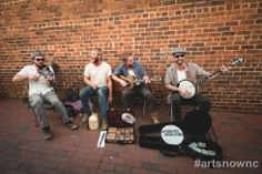 Images from Last Friday Art Walk in Hillsborough. Members of The Piedmont Regulators (left to right): Jesse Jordan on fiddle; Ernie Renn on spoons, jug and kazoo; Adam Rosemond on guitar; and Matt Singer on banjo. Their sound is old south but with a new and refreshing tempo that makes you want to move your feet.