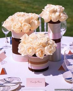 I totally can see using an oatmeal, formula, and powdered creamer cans to make these wrapped vases. gorgeous~