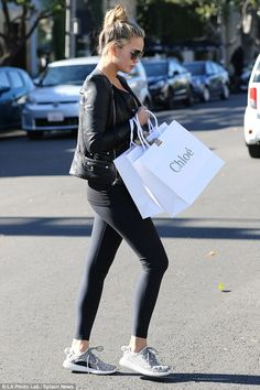 Designer style: Chrissy emerged from the Chloe boutique with two large bags...