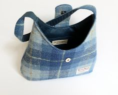 Harris Tweed Bag / Eco Friendly Blue Check Handmade Purse / Vegan Gift For Women   This bag is made with genuine Harris Tweed 100% wool fabric in a blue check pattern. Its lined with a matching blue medium weight cotton fabric and closes with a magnetic snap on the flap. It is fully interfaced and interlined to give it structure and durability.   Has 2 pockets inside, one is fastened by a zipper. The strap is the ideal size to either carry the bag in your hand or on your shoulder.   The…
