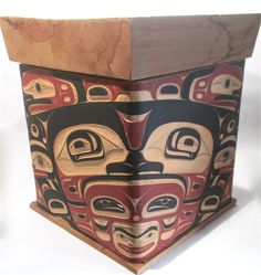 NWC cedar box with raven design, pigment and inlaid abalone.