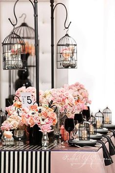 Table setting in black & pink, using small black bird cages